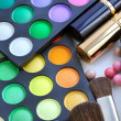 Professional eye shadows palette with makeup brushes and lipsticks — Stock Photo