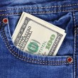 One hundred dollar bills in jeans pocket — Stock Photo