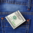 Dollar in a jeans pocket — 图库照片