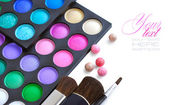 Professional eye shadows palette with makeup brushes on a white background — Stock Photo