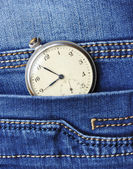 Old pocket watch in the pocket of blue jeans — Stock Photo