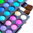Professional eye shadows palette with makeup brushes on a white background — Stock Photo #35604441
