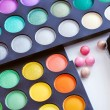Professional eye shadows palette with makeup brush — Stock Photo