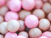 Pink cosmetics rouge balls, macro — Stock Photo