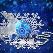 Christmas decorations and deer are on a blue festive  — Stock Photo