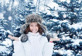 Young woman in winter forest — Stock Photo