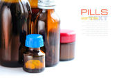 Bottles with pills on a white background (with sample text) — Stock Photo