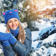 Winter woman play snowballs on snow background — Stock Photo #36505151