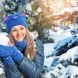 Winter woman play snowballs on snow background — Stock Photo