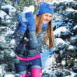 Winter woman play snowballs on snow background — Stock Photo #36505161