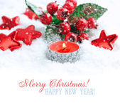 Christmas candle with decorations on snow with space for text — Stock Photo
