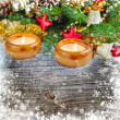 Christmas composition is with candles on a snowbound wooden background — Stock Photo #36961443