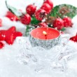 Stock Photo: Christmas candle is with decorations on snow