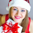 Beautiful young woman with Christmas gift — Stock Photo
