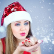 Portrait of beautiful sexy girl wearing santa claus hat — Stock Photo #36961539