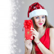 Stock Photo: Beautiful young woman with Christmas gift