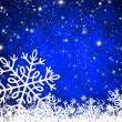 Christmas blue background with snowflakes — Stock Photo