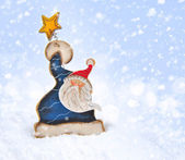 Santa Claus on a christmas blue background — Stock Photo