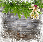 Christmas decoration with branches of spruce on a winter wooden background — Stock Photo