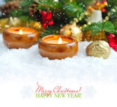 Christmas composition is with candles on snow — 图库照片