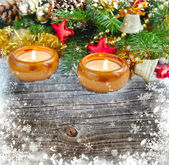 Christmas composition is with candles on a snowbound wooden background — Foto Stock