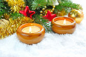 Christmas composition is with candles on snow — Foto Stock