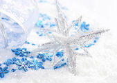 Christmas blue and silver decorations on snow — Stock Photo