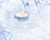 Christmas candle on a festive background — Stock Photo
