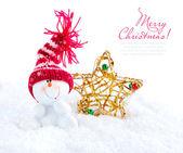 Snowman with christmas star on snow — Stock Photo