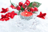 A christmas candle is with decorations on snow — Foto de Stock