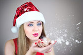 Portrait of beautiful sexy girl wearing santa claus hat — Stock Photo