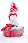 Snowman sitting on gift box — Stok fotoğraf