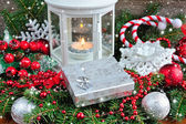 Christmas composition with silver gift and lantern — Stok fotoğraf