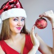 Attractive young womholding red Christmas ball — Stock fotografie #37338877