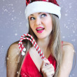图库照片: Beautiful young womin santclaus hat