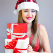 Portrait of beautiful girl with Christmas gifts — Stock fotografie #37338903