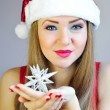 Attractive young womholding Christmas decoration star — Stock fotografie #37338907