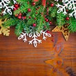 Christmas decorations of bauble with the branches of fir on a wooden background — Stock Photo