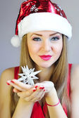 Attractive young woman holding Christmas decoration star — Stock Photo