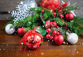 Branches of spruce are with christmas decorations on wooden background — ストック写真