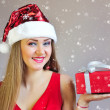 Portrait of beautiful sexy girl with Christmas gift — Stock Photo #37731945