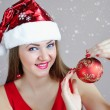 Attractive young womholding red Christmas ball — Stock Photo #37731947
