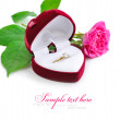 Red velvet box with golden ring and pink rose on a white background — Stock Photo #40499113