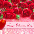 Red roses with a heart on a background a wrapping paper — Stock Photo #40499131