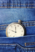 Old pocket watch in the pocket of blue jeans — Foto de Stock