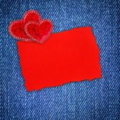Decorative hearts and a blank form for greeting jeans background — Stock Photo