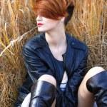 Beautiful sensual girl posing in the grass — Stock Photo