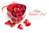Red Roses in Gift Box and decorative Hearts on White Background — Stock Photo