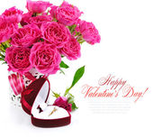 Red velvet box with golden ring and bouquet of pink roses on a white background — Stock Photo
