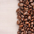 Stock Photo: Coffee beans on linen background
